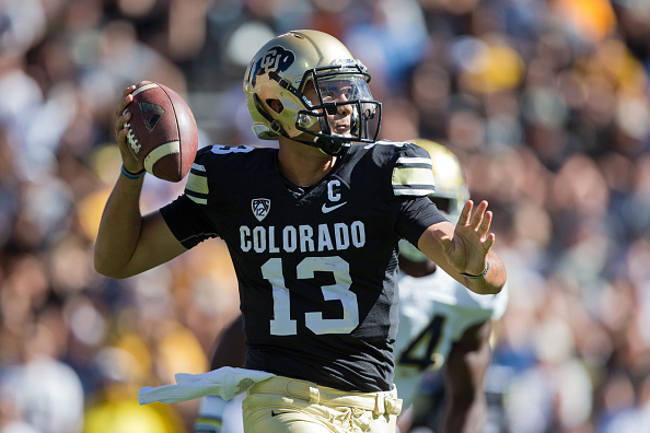 Quarterback Sefo Liufau #13 of the Colorado Buffaloes throws a pass during the first quarter against the UCLA Bruins at Folsom Field on October 25, 2014 in Boulder, Colorado. (Photo by Justin Edmonds/Getty Images)