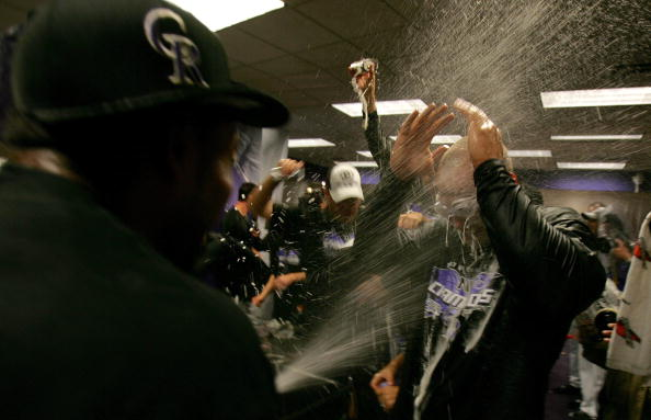 The Rockies celebrate their 6-4 win against the Arizona Diamondbacks during Game 4 of the National League Championship Series on Oct. 15, 2007, in Denver. (Photo by Doug Pensinger/Getty Images)