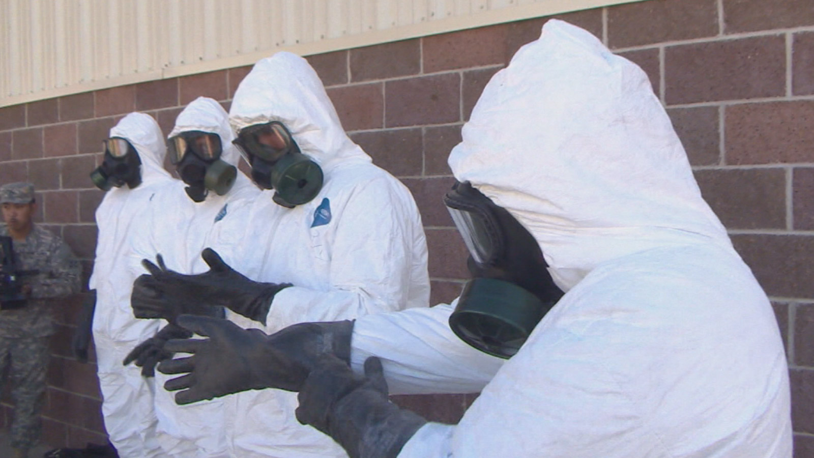 Fort Carson soldiers suit up for Ebola deployment in October (credit: CBS)