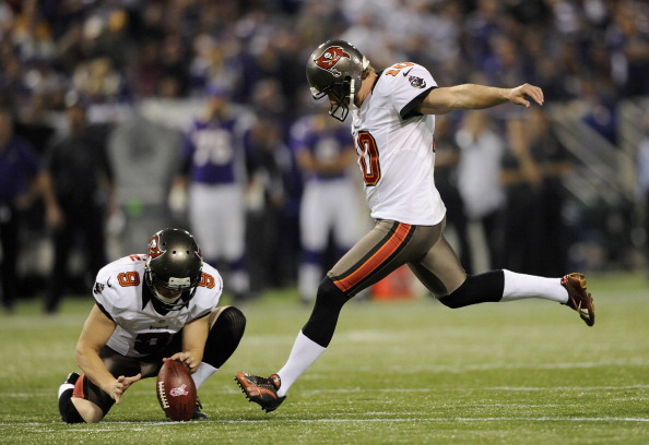 Michael Koenen #9 of the Tampa Bay Buccaneers holds the ball as Connor Barth #10 of the Tampa Bay Buccaneers kicks a field goal during the second quarter of the game against the Minnesota Vikings on October 25, 2012 at Mall of America Field at the Hubert H. Humphrey Metrodome in Minneapolis, Minnesota. (Photo by Hannah Foslien/Getty Images)