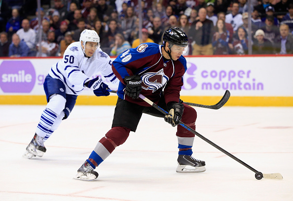 Alex Tanguay #40 of the Colorado Avalanche controls the puck against Stuart Percy #50 of the Toronto Maple Leafs at Pepsi Center on November 6, 2014 in Denver, Colorado. (Photo by Doug Pensinger/Getty Images)