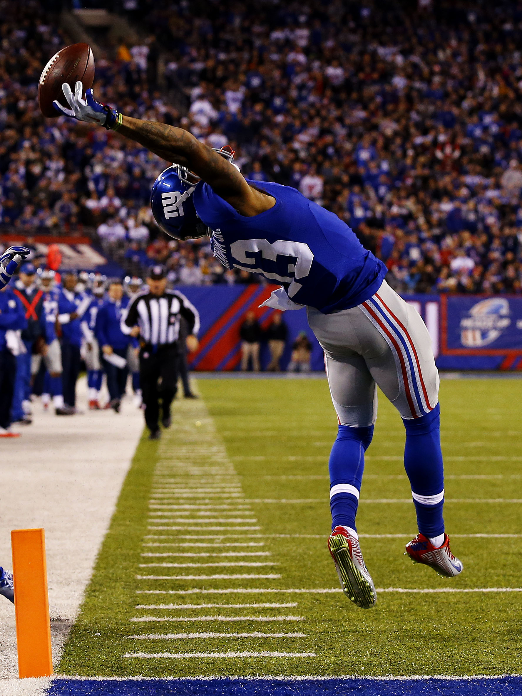Odell Beckham Jr. of the New York Giants scores a touchdown in the second quarter against the Dallas Cowboys at MetLife Stadium on Nov. 23, 2014 in East Rutherford, New Jersey.  (credit: Al Bello/Getty Images)