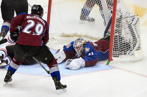 Goalie Calvin Pickard #31 of the Colorado Avalanche makes a save as Nathan MacKinnon #29 of the Colorado Avalanche follows the play against the Chicago Blackhawks at Pepsi Center on November 26, 2014 in Denver, Colorado. The Blackhawks defeated the Avalanche 3-2.  (Photo by Doug Pensinger/Getty Images)