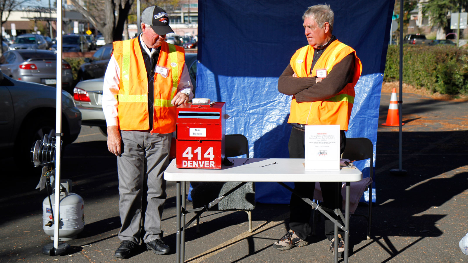 Election judges supervise a drive-thru voting location on Tuesday at a polling center in Denver. (credit: CBS4)