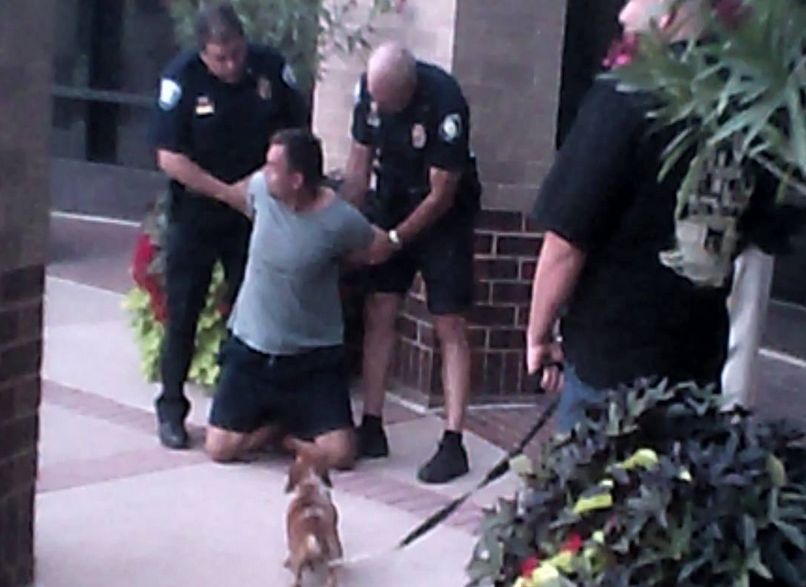 Eric Brandt being arrested outside of the Westminster City Council meeting on Aug. 11, 2014 (credit: Eric Brandt/Facebook)