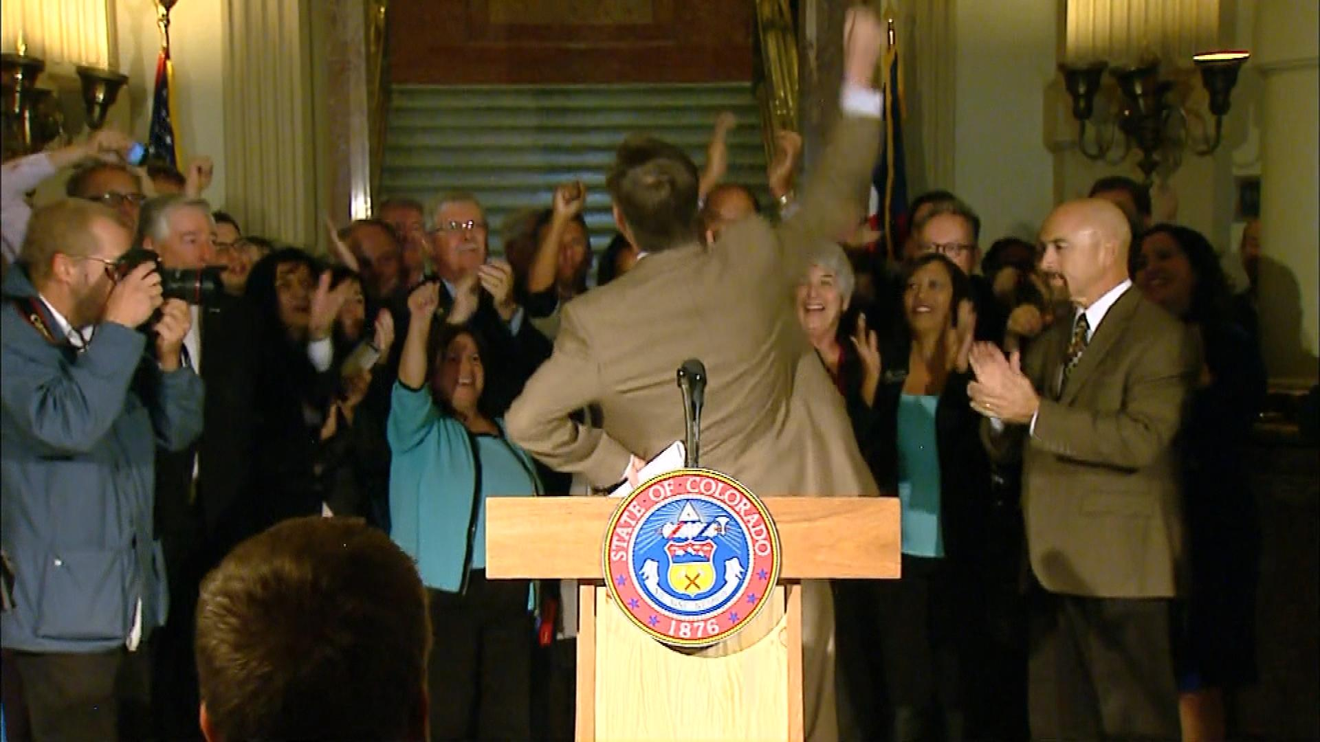 Gov. John Hickenlooper cheers with supporters before declaring victory in the gubernatorial race on Nov. 5, 2014. (credit: CBS)