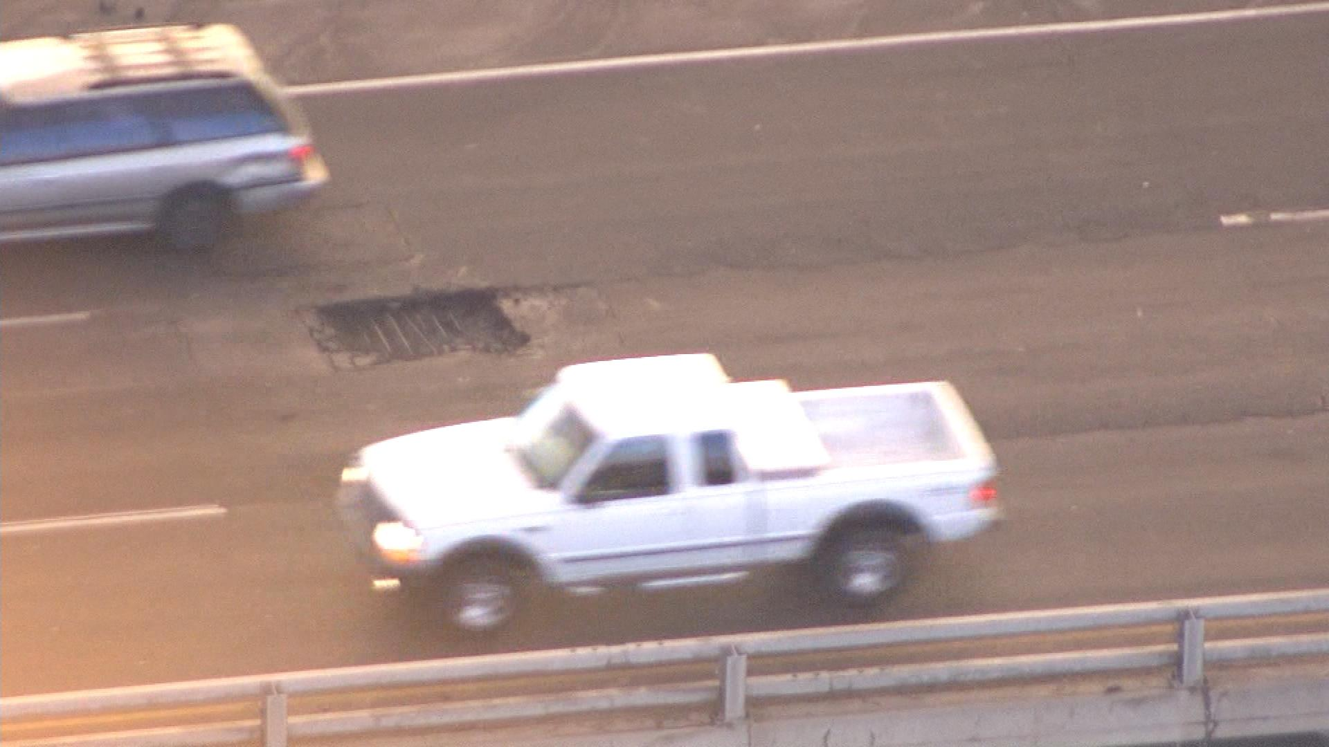 The pothole on I-70 (credit: CBS)