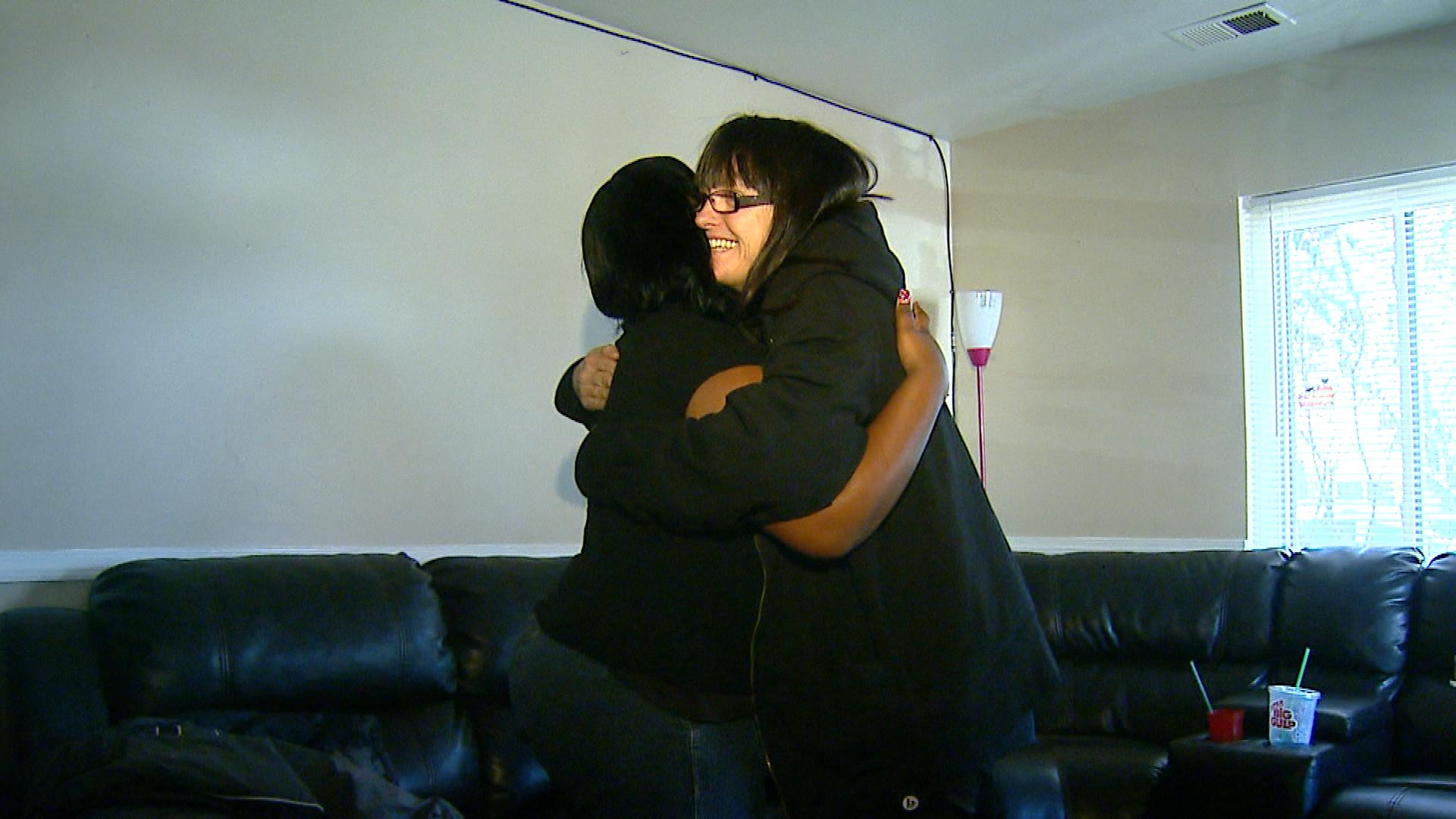 Shanequa Lewis shares a hug with There With Care founder Paula Dupre Pesmen (credit: CBS)