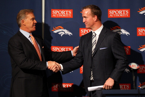 John Elway welcomes Peyton Manning to the Broncos organization (file photo credit: Justin Edmonds/Getty Images)