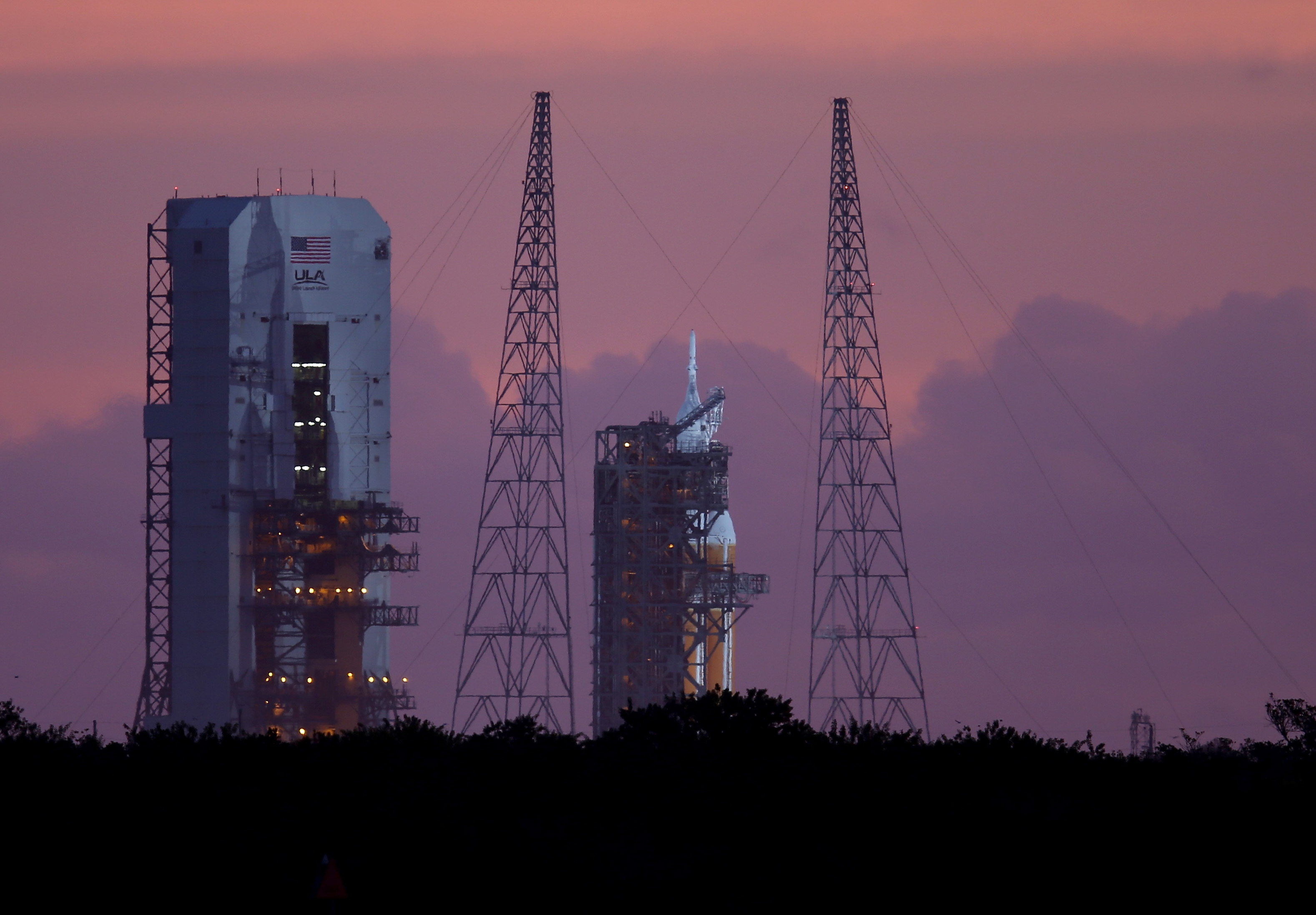 The United Launch Alliance Delta 4 rocket carrying NASA's first Orion deep space exploration craft is seen on its launch pad before the mornings mission was scrubbed on December 4, 2014 in Cape Canaveral, Florida.  The heavy-lift rocket will boost the unmanned Orion capsule to an altitude of 3,600 miles, and returning for a splashdown west of Baja California after a four and half hour flight.  (Photo by Joe Raedle/Getty Images)