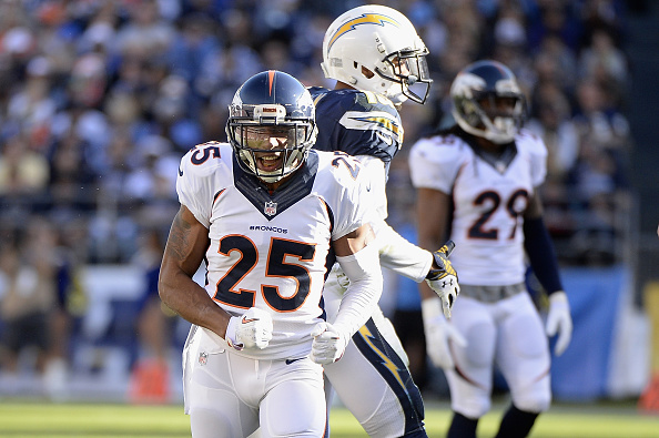 Cornerback Chris Harris #25 of the Denver Broncos celebrates a defensive stop against the San Diego Chargers at Qualcomm Stadium on December 14, 2014 in San Diego, California.  (Photo by Harry How/Getty Images)