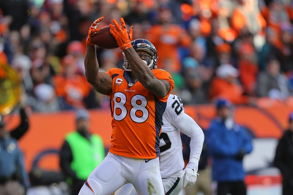 Wide receiver Demaryius Thomas #88 of the Denver Broncos makes a catch for a 23 yard gain and a first down at the 1-yard line against the Oakland Raiders at Sports Authority Field at Mile High on December 28, 2014 in Denver, Colorado.  (Photo by Justin Edmonds/Getty Images)