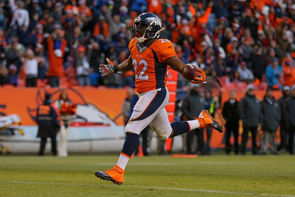 Running back C.J. Anderson #22 of the Denver Broncos rushes for a third quarter rushing touchdown against the Oakland Raiders (his third of the game) at Sports Authority Field at Mile High on December 28, 2014 in Denver, Colorado. (Photo by Justin Edmonds/Getty Images)
