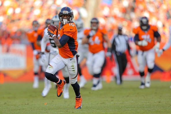 Wide receiver Emmanuel Sanders #10 of the Denver Broncos runs after a catch against the Oakland Raiders during a game at Sports Authority Field at Mile High on December 28, 2014 in Denver, Colorado. (Photo by Justin Edmonds/Getty Images)