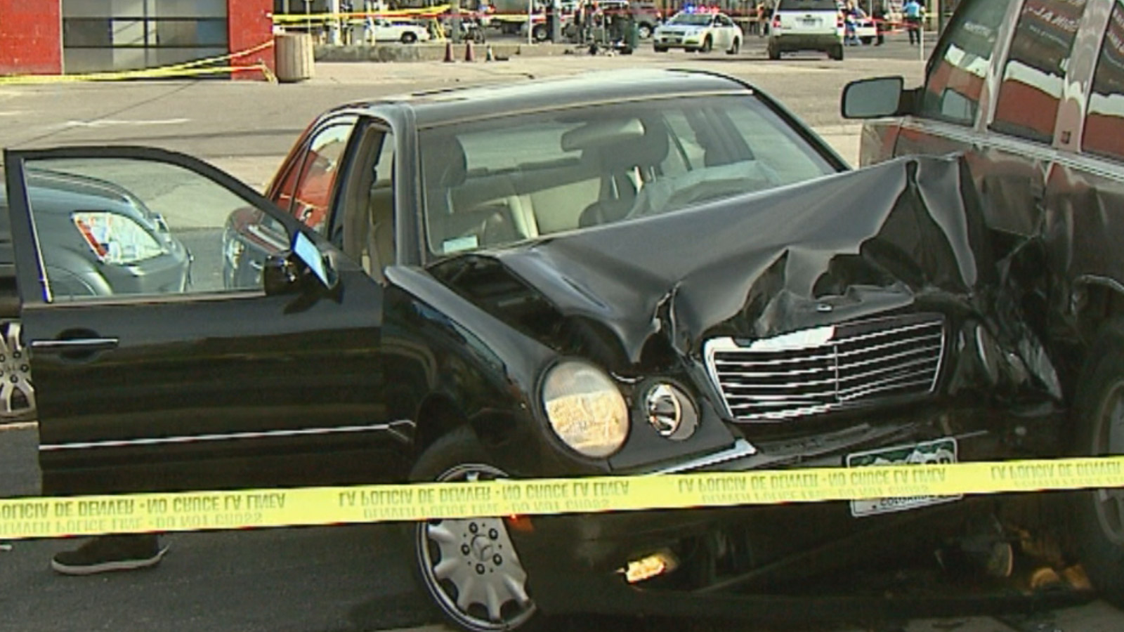 The black Mercedes driven by Christopher Booker that struck four Denver Police officers (credit: CBS)