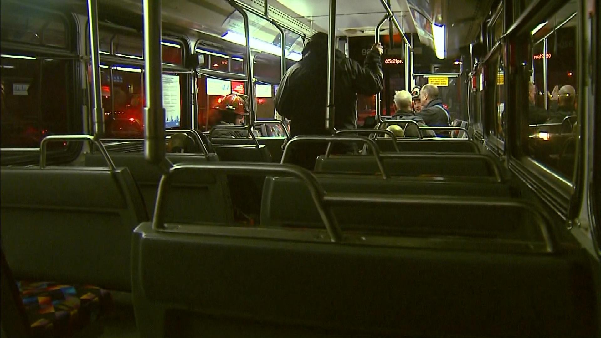 Firefighters warm up in an RTD bus (credit: CBS)