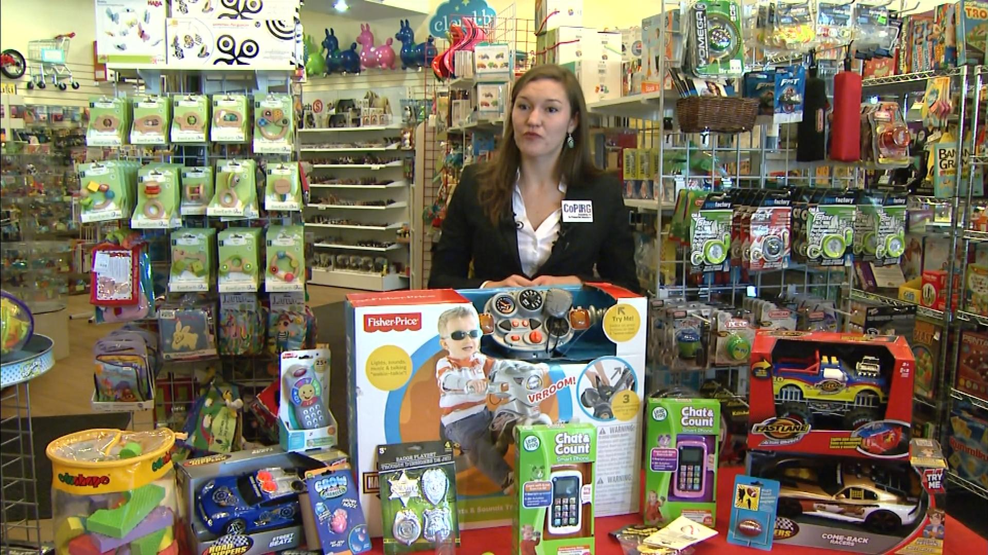 Lisa Ritland with CoPIRG shows off dangerous toys (credit: CBS)