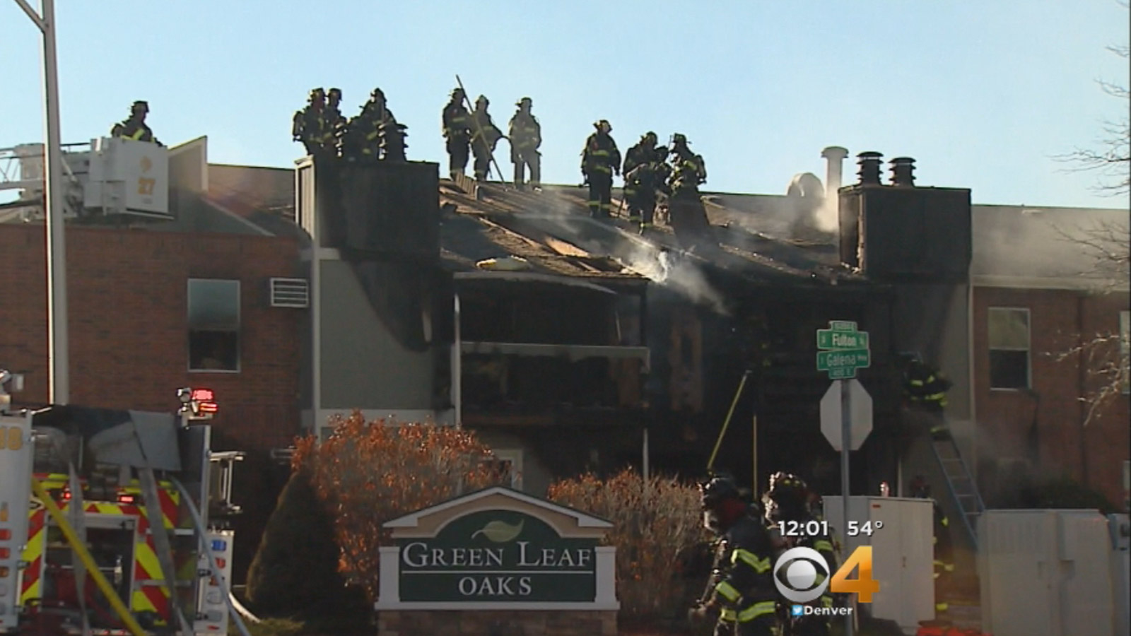 Denver Firefighters battle a 2-alarm fire at an apartment complex Friday morning. (credit: CBS)