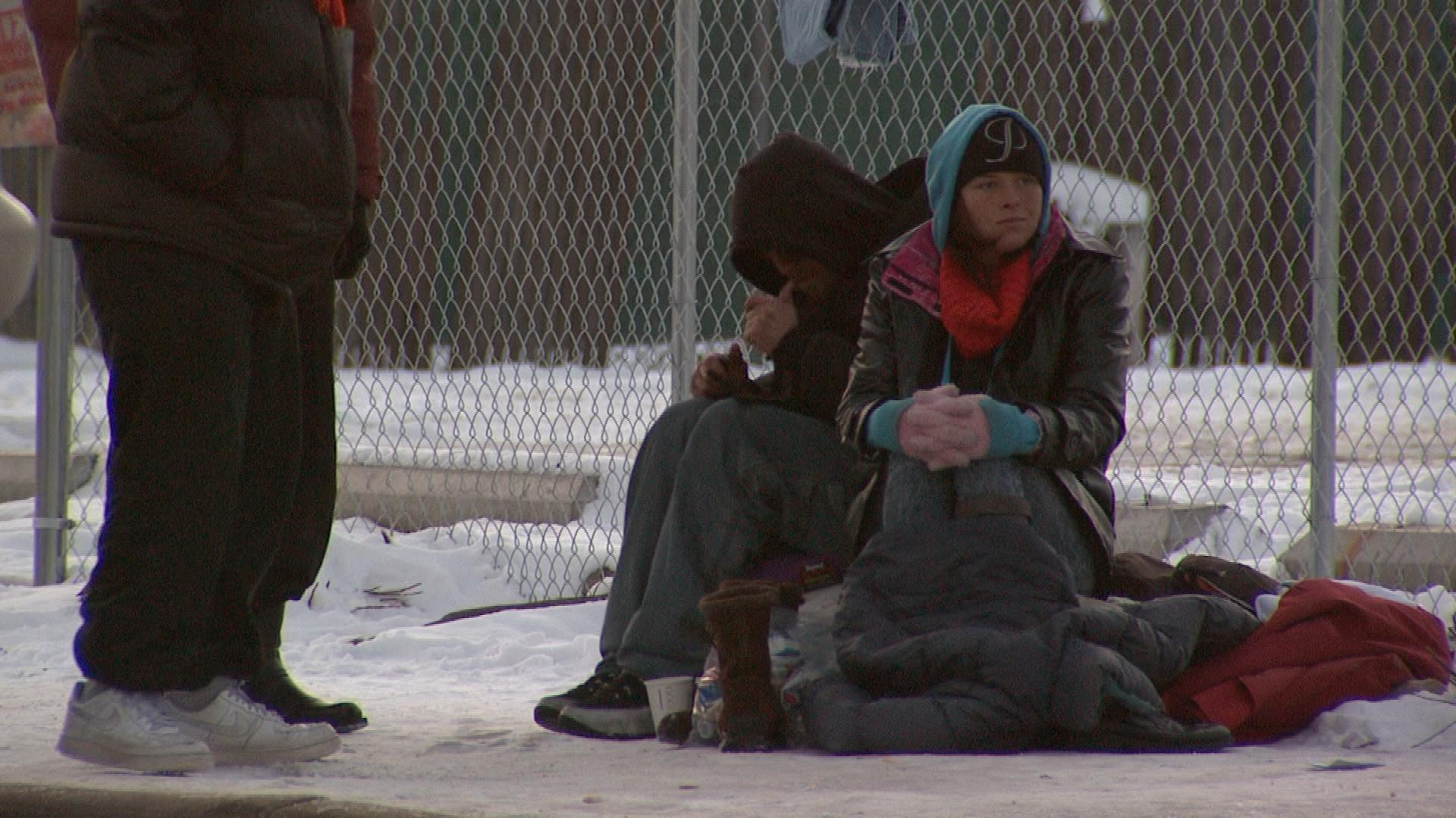 Homeless people outside the Denver Rescue Mission (credit: CBS)