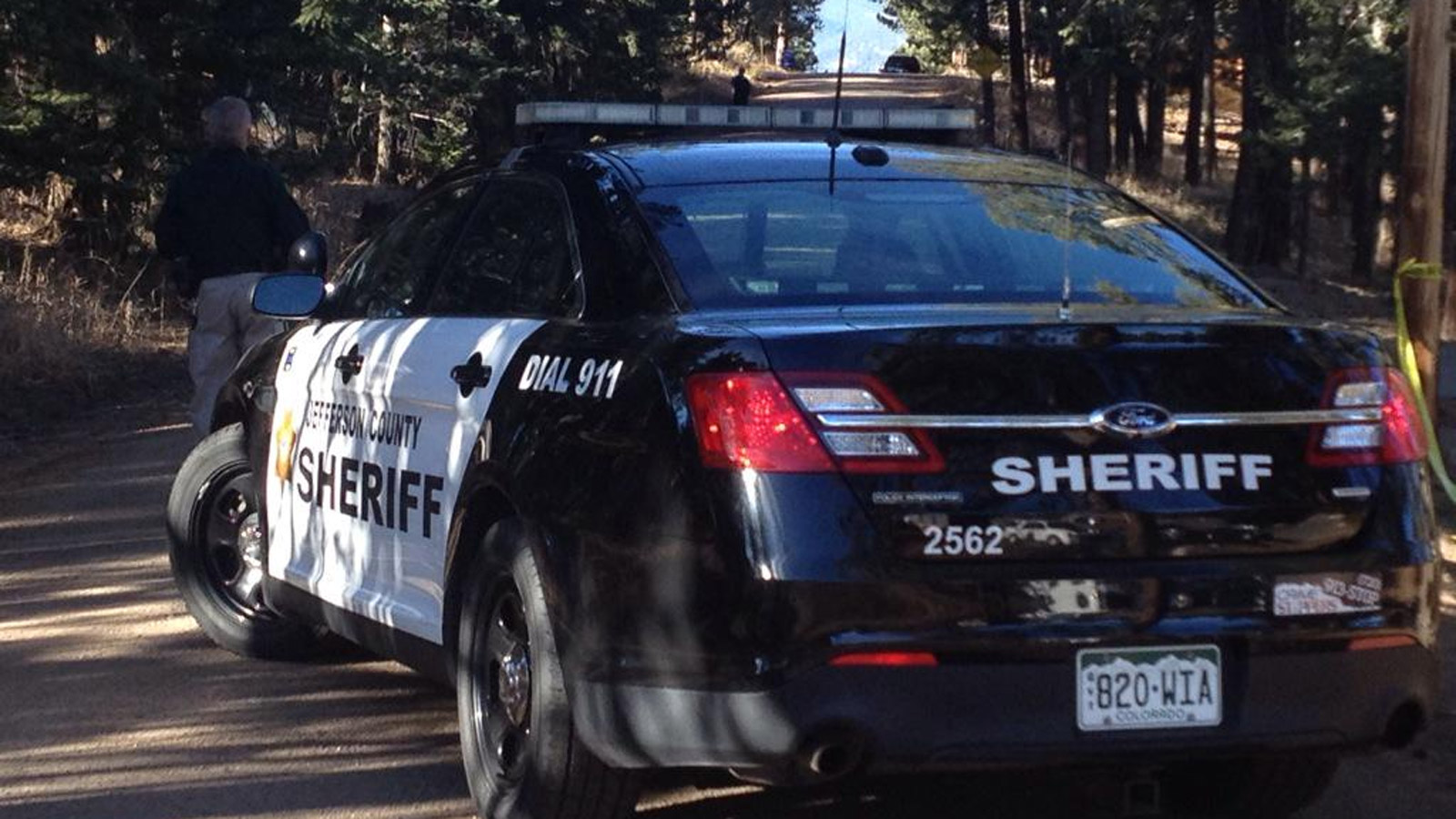 A Jeffco Sheriff's deputy near the home invasion where an intruder was shot and killed (credit: CBS)