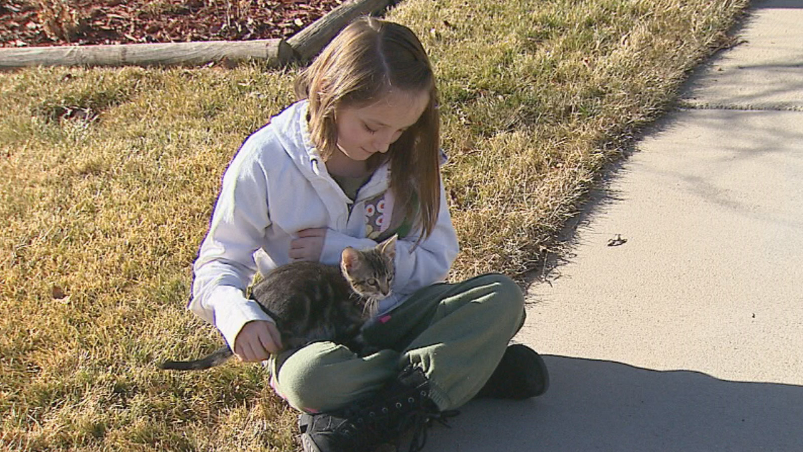 Miah with her cat, Kai (credit: CBS)