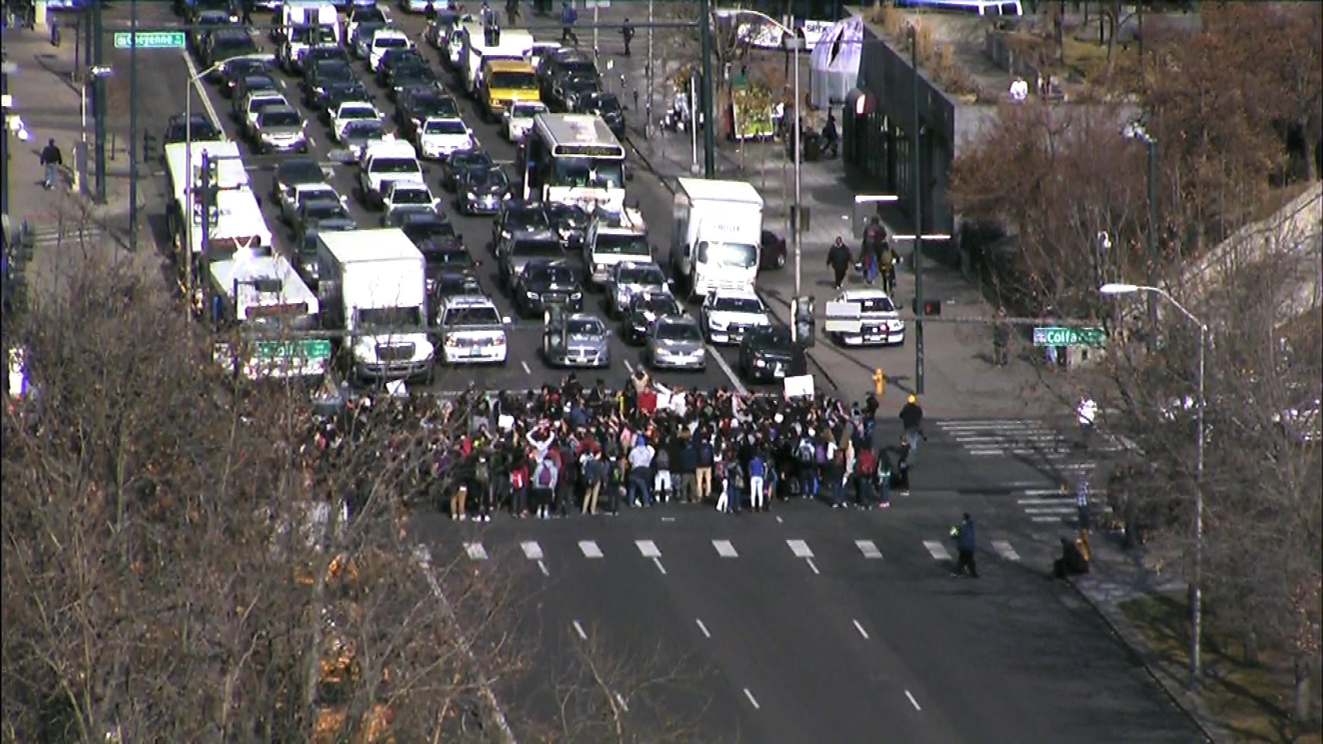 Student blocking the intersection of Lincoln Street and Colfax Avenue (credit: CBS)