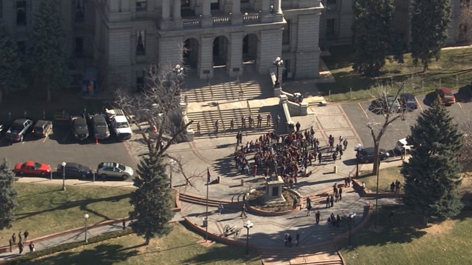 Copter4 flew over a small crowd of protesters at the state Capitol on Friday morning (credit: CBS)
