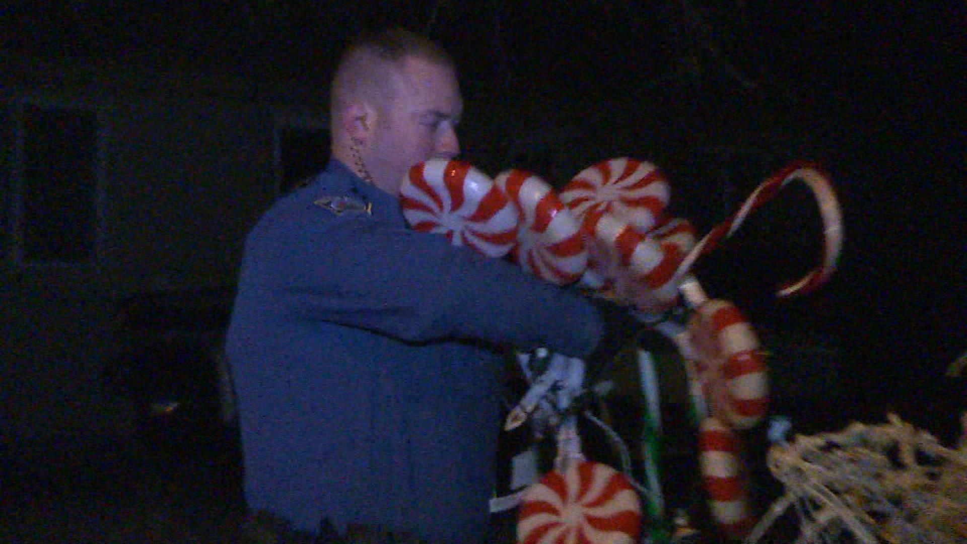 Law enforcement removes some of the decorations. (credit: KKTV)