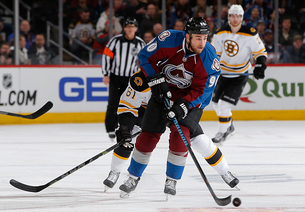 Ryan O'Reilly #90 of the Colorado Avalanche controls the puck against Craig Cunningham #61 of the Boston Bruins at Pepsi Center on January 21, 2015 in Denver, Colorado.  (Photo by Doug Pensinger/Getty Images)