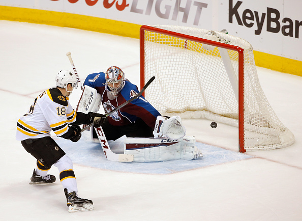 Reilly Smith #18 of the Boston Bruins takes a shot wide against goalie Semyon Varlamov #1 of the Colorado Avalanche during an overtime shootout at Pepsi Center on January 21, 2015 in Denver, Colorado. The Avalanche defeated the Bruins 3-2 in an overtime shootout.  (Photo by Doug Pensinger/Getty Images)
