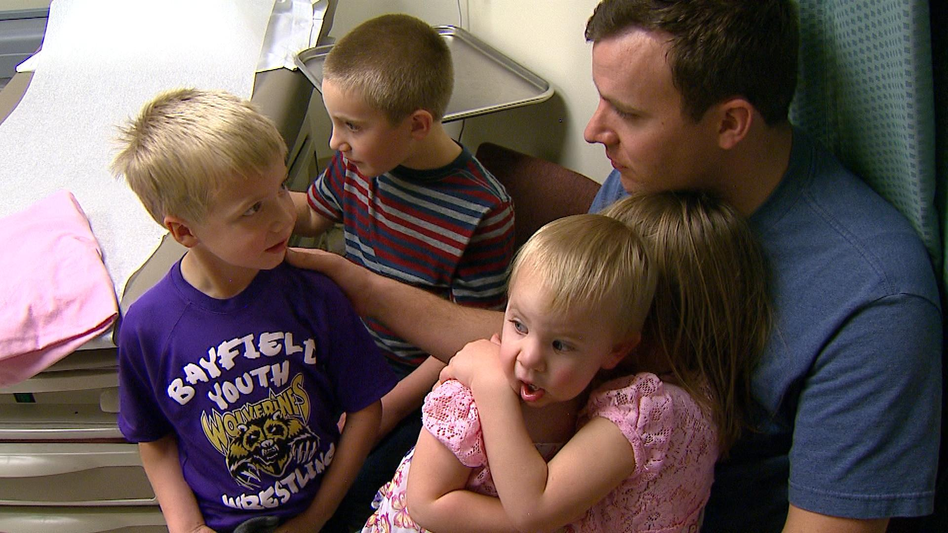Ben Choate with the kids (credit: CBS)
