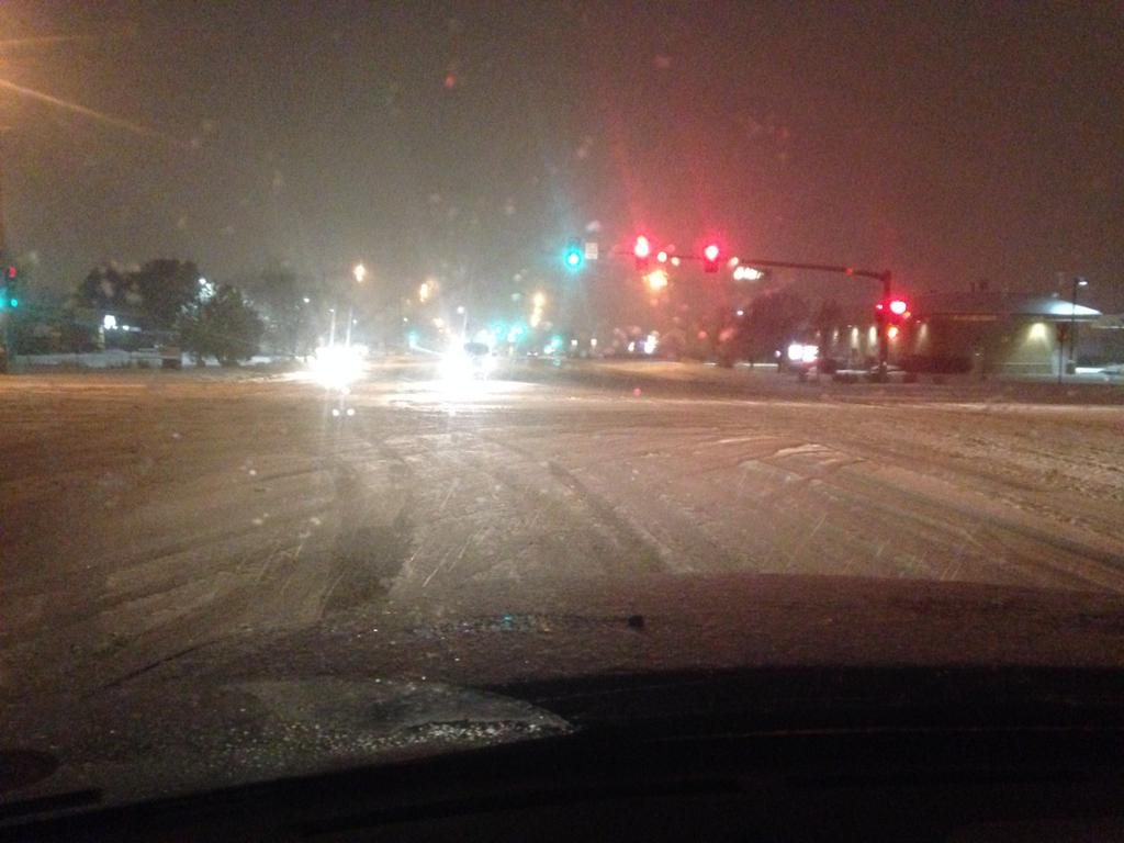The intersection at 6th and Airport in east Aurora was icy and snow packed New Year's night. (credit: CBS4 Meteorologist Chris Spears)