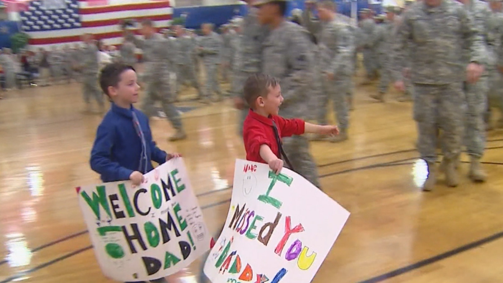 Children of a Fort Carson soldier run to greet him at a homecoming ceremony on Thursday (credit: CBS)