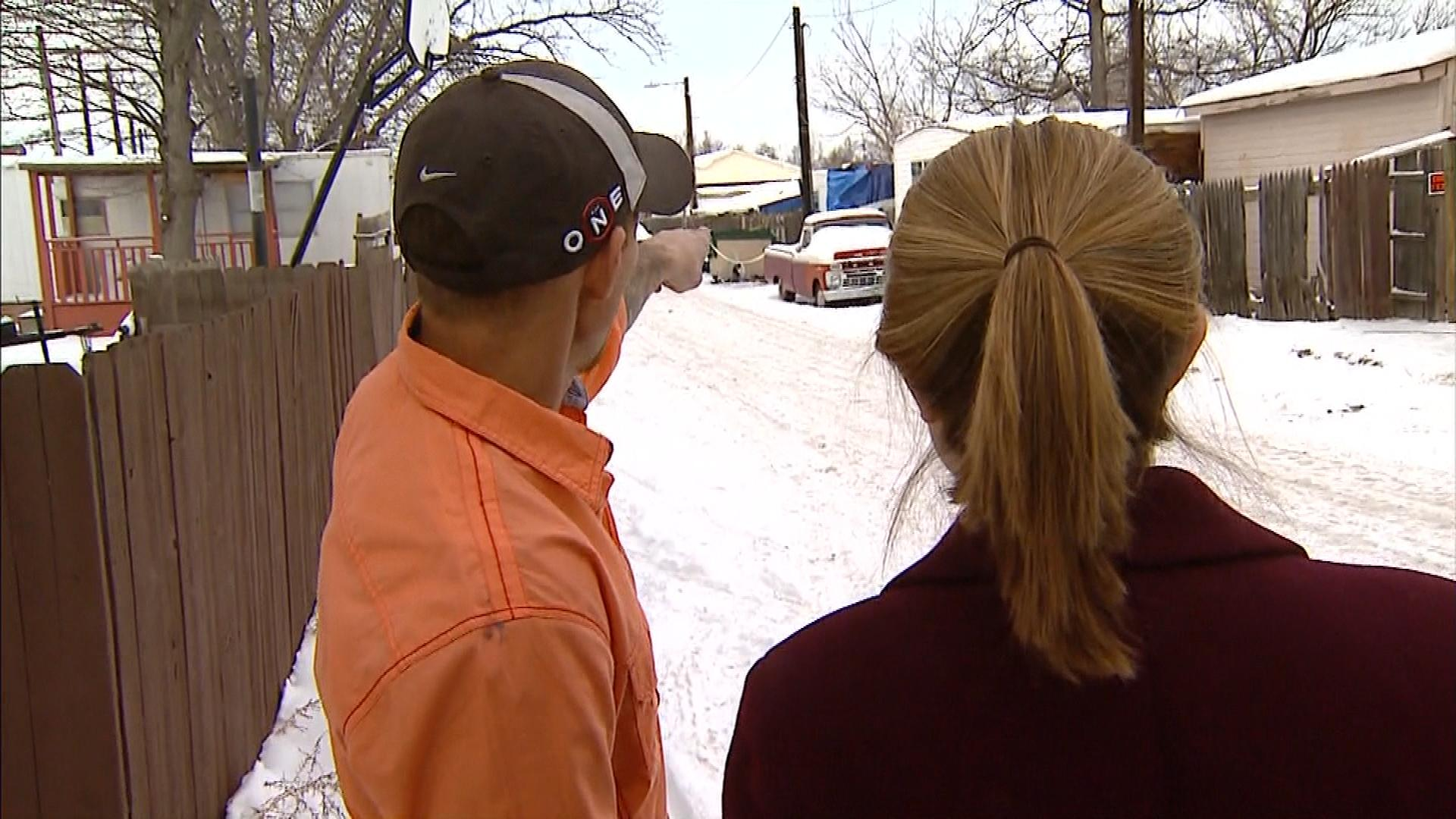 Sean Stoos shows CBS4's Lauren DiSpirito the distance between his home and the fire (credit: CBS)