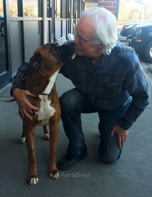Tyni with the vet who helped him (credit: Fox Hollow Animal Clinic)