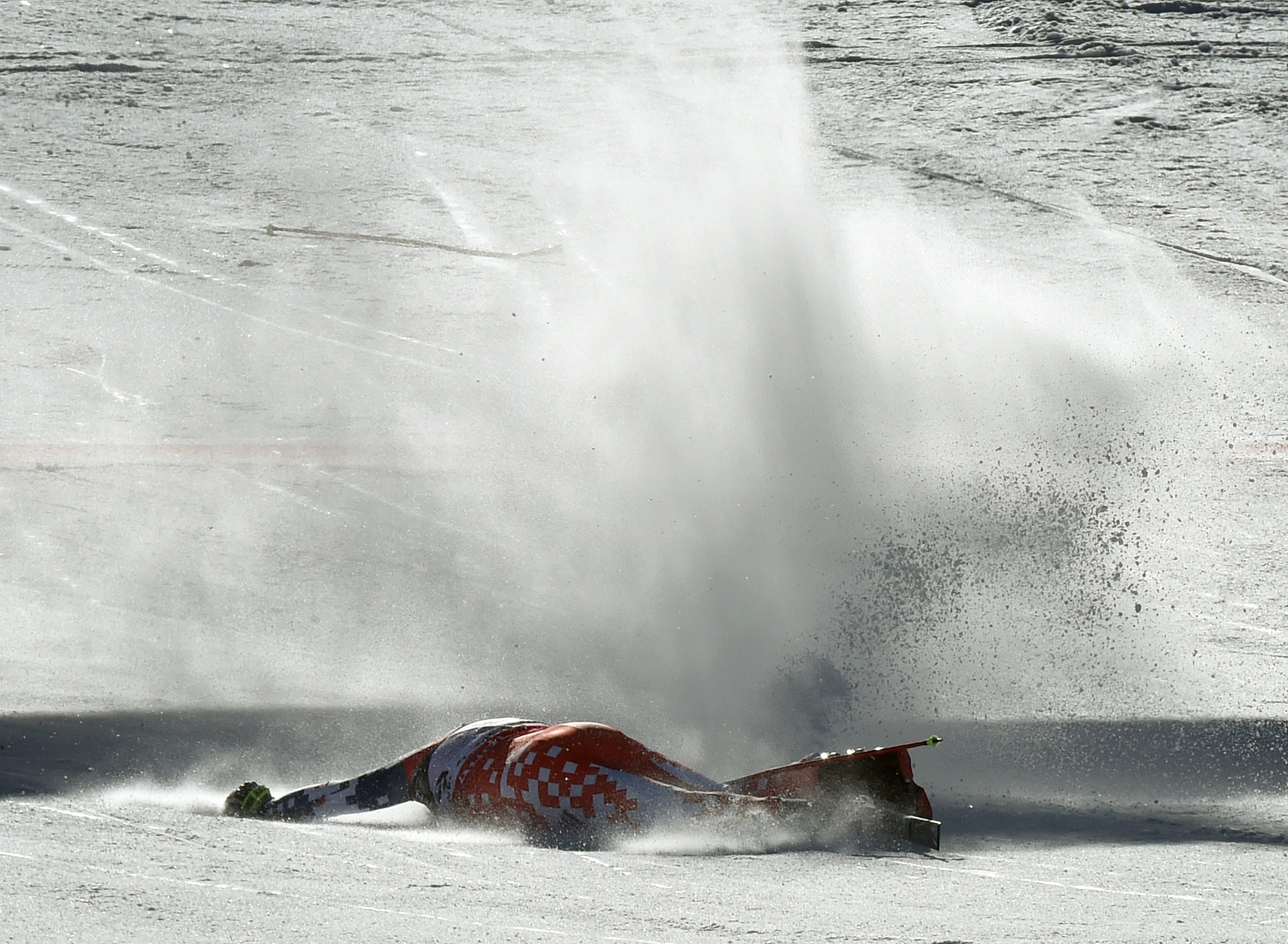 Ondrej Bank of the Czech Republic slides near the finish line after crashing during the 2015 World Alpine Ski Championships men's combined-downhill February 8, 2015 in Beaver Creek, Colorado.    (credit: MARK RALSTON/AFP/Getty Images)