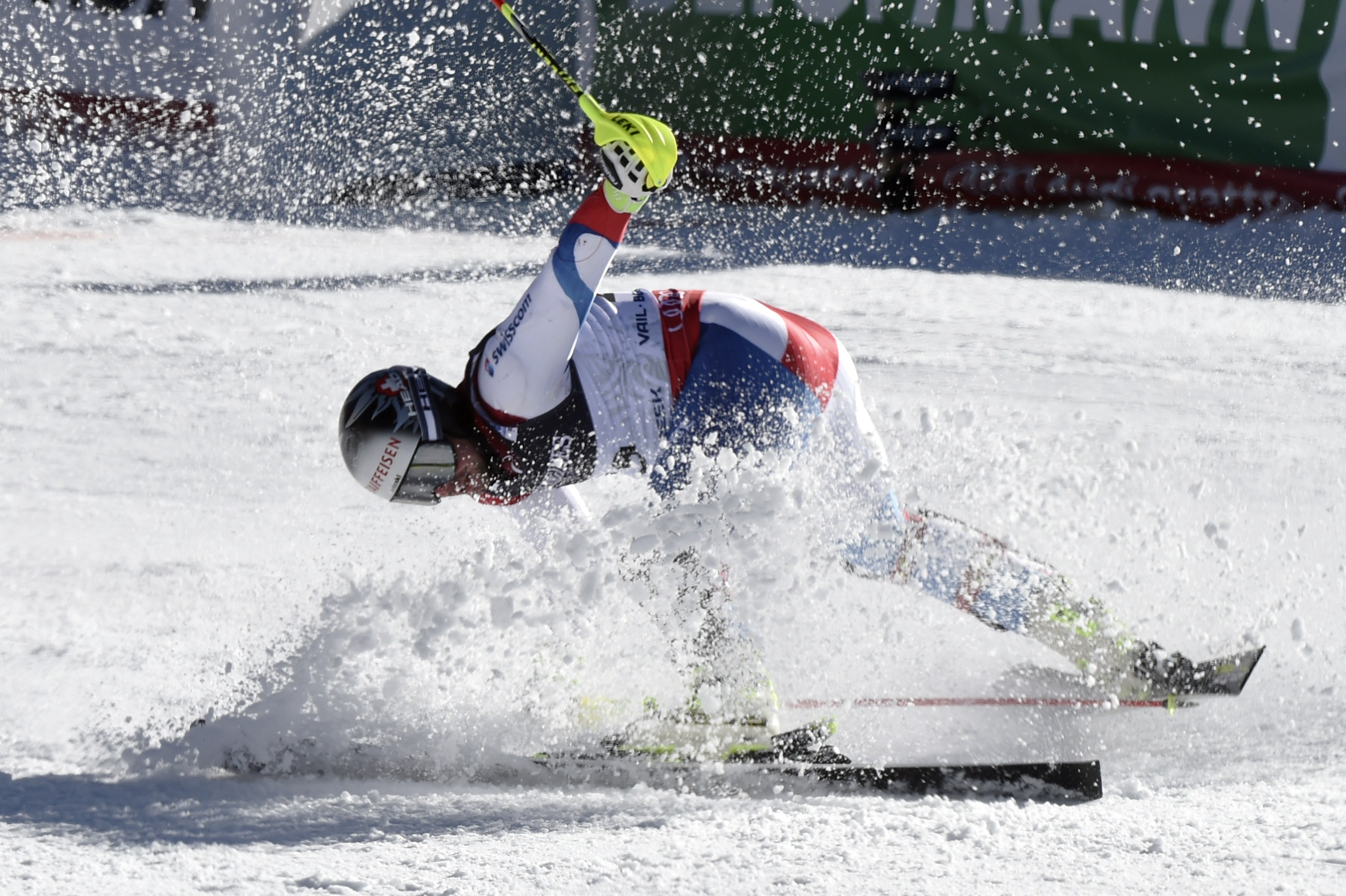 Switzerland's Beat Feuz crashes in the finish area of the 2015 World Alpine Ski Championships men's combined, on February 8, 2015 in Beaver Creek, Colorado.  (credit: MARK RALSTON/AFP/Getty Images)