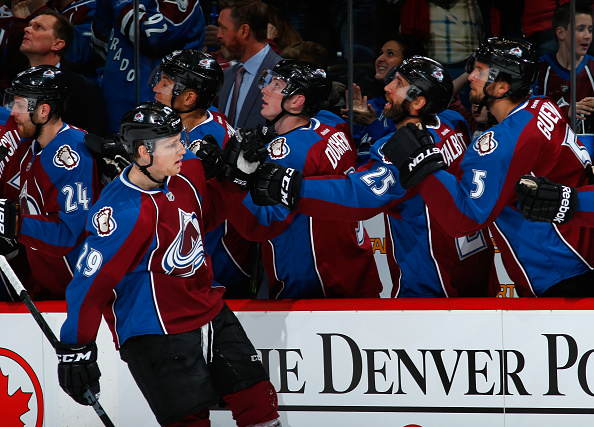 Nathan MacKinnon #29 of the Colorado Avalanche celebrates his goal against the Tampa Bay Lightning with his teammates to tie the score 1-1 in the first period at Pepsi Center on February 22, 2015.  (Photo by Doug Pensinger/Getty Images)