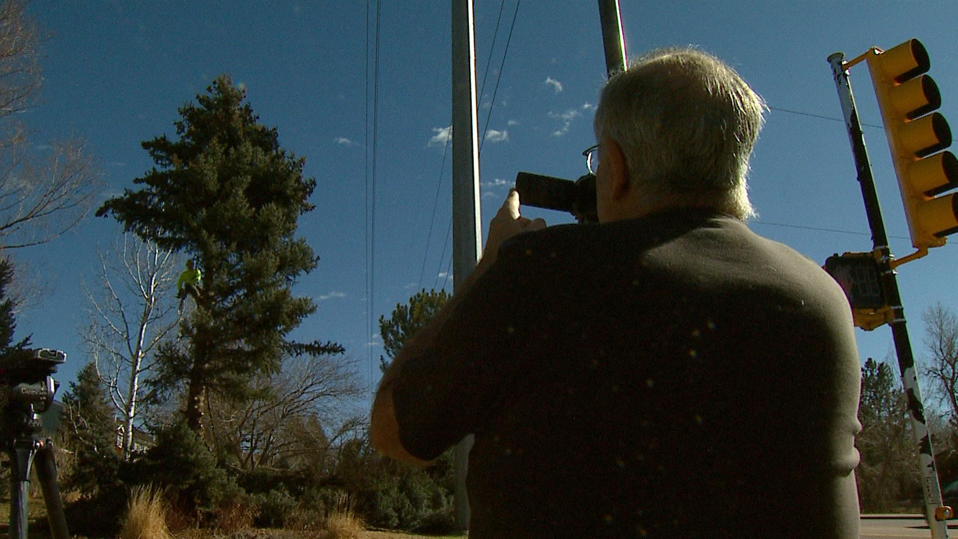 Mill Creek Homes Association member Steve Wennerstrom  takes video of trees being cut down (credit: CBS)
