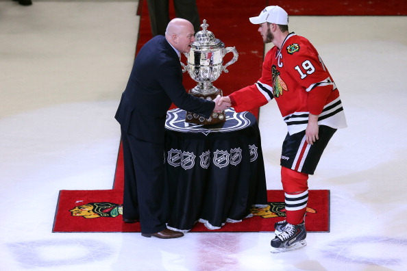 Jonathan Toews #19 of the Chicago Blackhawks is careful not to touch the Clarence S. Campbell Bowl while shaking hands with Deputy Commissioner Bill Daley after the Blackhawks won 4-3 in the second overtime against the Los Angeles Kings during Game Five of the Western Conference Finals of the 2013 NHL Stanley Cup Playoffs at United Center on June 8, 2013 in Chicago, Illinois.  (Photo by Jonathan Daniel/Getty Images)