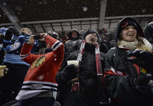 Fans cheer during the singing of the National Anthem before the 2014 Coors Light NHL Stadium Series game between the Chicago Blackhawks and the Pittsburgh Penguins at Soldier Field on March 1, 2014 in Chicago, Illinois.  (Photo by Brian Kersey/Getty Images)