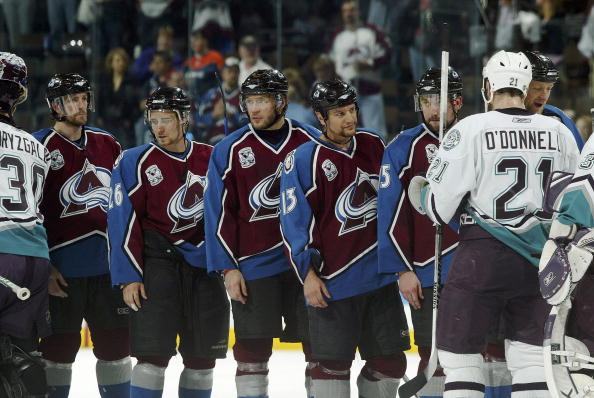 The Colorado Avalanche line up to shake the hands of the Mighty Ducks of Anaheim after getting swept in four games in the Western Conference Semifinals during the 2006 NHL Playoffs on May 11, 2006 at the Pepsi Center in Denver, Colorado. The Mighty Ducks defeated the Avalanche 4-1 in game four to sweep the series 4-0.  (Photo by Brian Bahr/Getty Images)