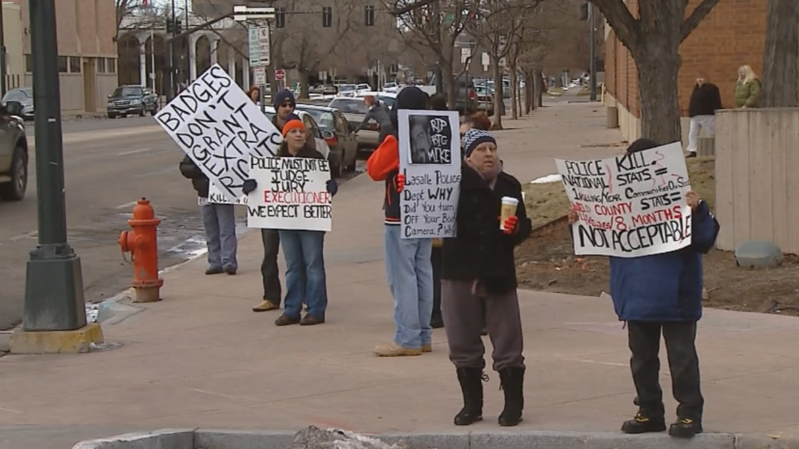 Protesters gathered outside the Weld County DA's office on Wednesday (credit: CBS)