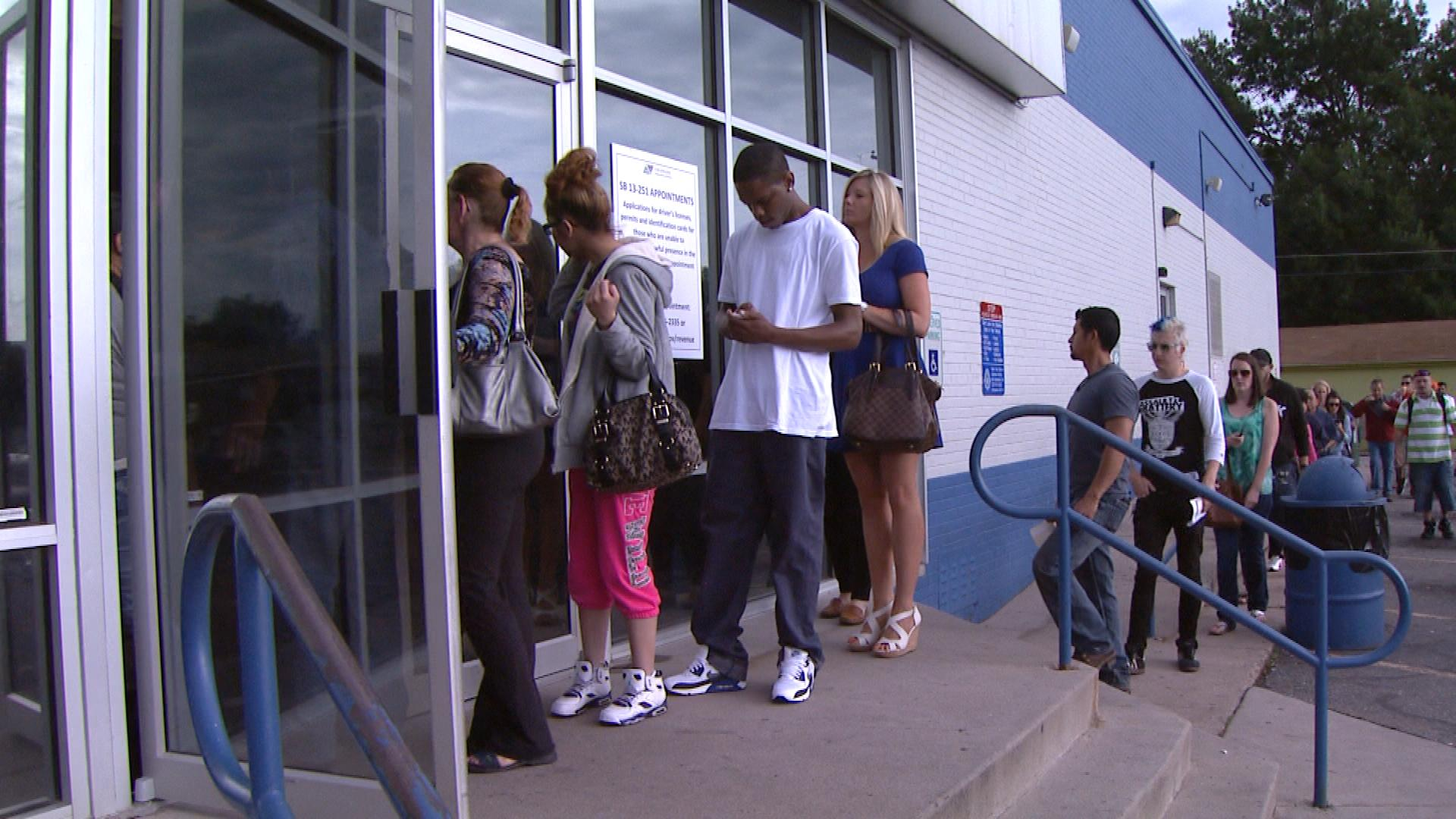 A line at the DMV office on West Mississippi Avenue in Denver (credit: CBS)
