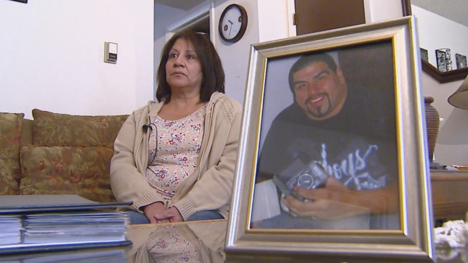 Lollie Rios with a picture of her son, Michael Rodriguez (credit: CBS)
