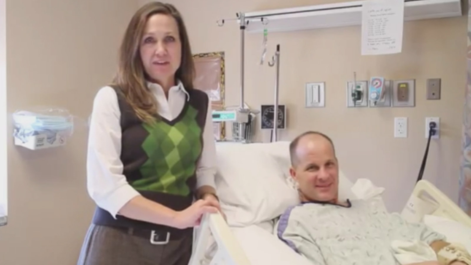 DPD Officer John Adsit seen recovering in the hospital after he was run over during a student protest in December 2014. (credit: YouTube)
