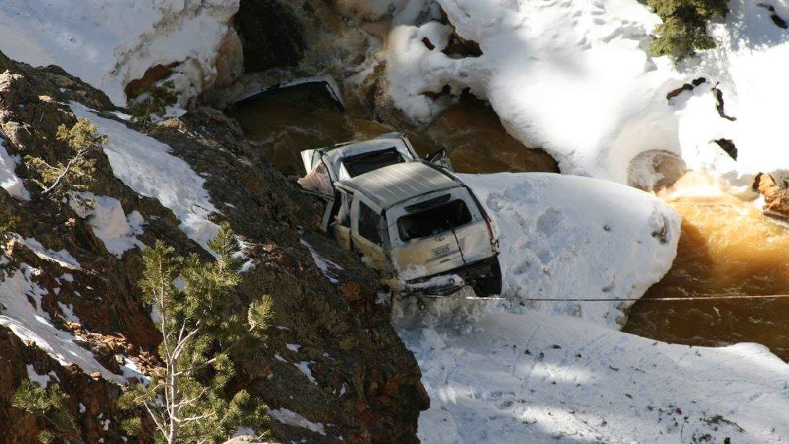 Crews raised the car from Red Mountain Pass on Thursday (credit: CDOT)