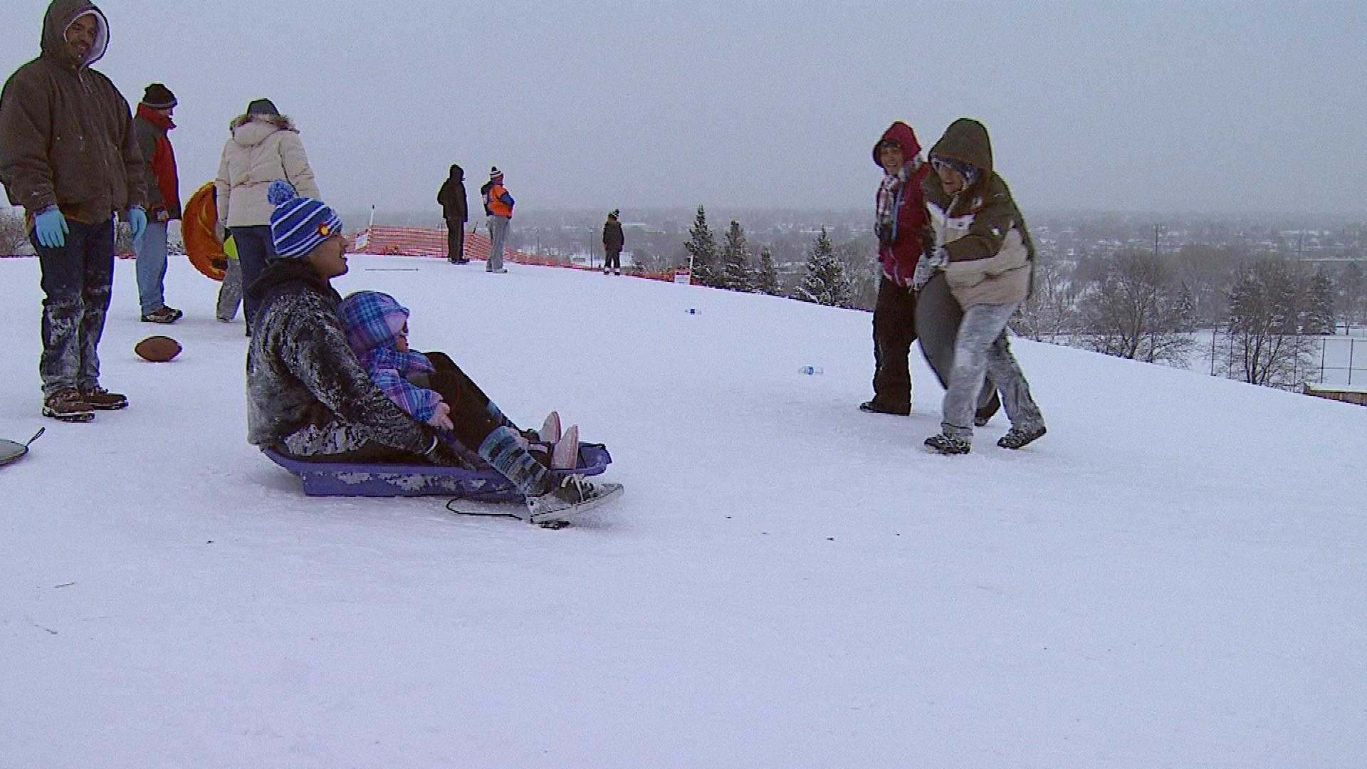 Sledding in Denver on Thursday at Ruby Hill (credit: CBS)