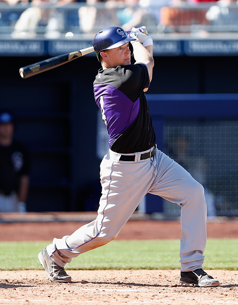Nick Hundley #4 of the Colorado Rockies hits a RBI double against the San Diego Padres during the third inning of the spring training game at Peoria Stadium on March 8, 2015 in Peoria, Arizona.  (Photo by Christian Petersen/Getty Images)