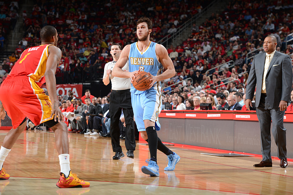 Danilo Gallinari #8 of the Denver Nuggets looks to move the ball against the Houston Rockets during the game on March 19, 2015 at the Toyota Center in Houston, Texas. (Photo by Garrett Ellwood/NBAE via Getty Images)